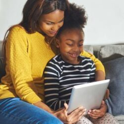 African American Mother And Child With Tablet Smiling