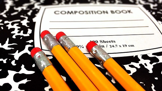 Composition book with pencils