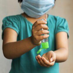 Girl using hand sanitizer