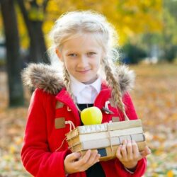 Autumn Girl Smiling With Books In The Fall