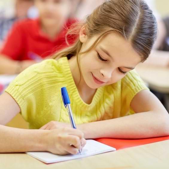Girl In Yellow Shirt Writing In Notebook